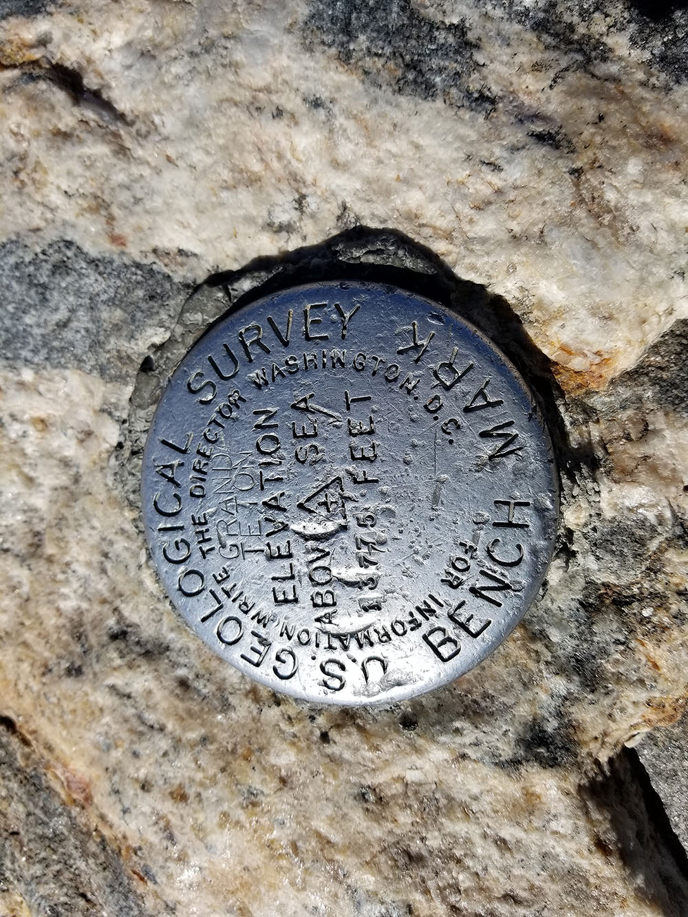 The summit marker on the Grand Teton, 13,775 feet above sea level
