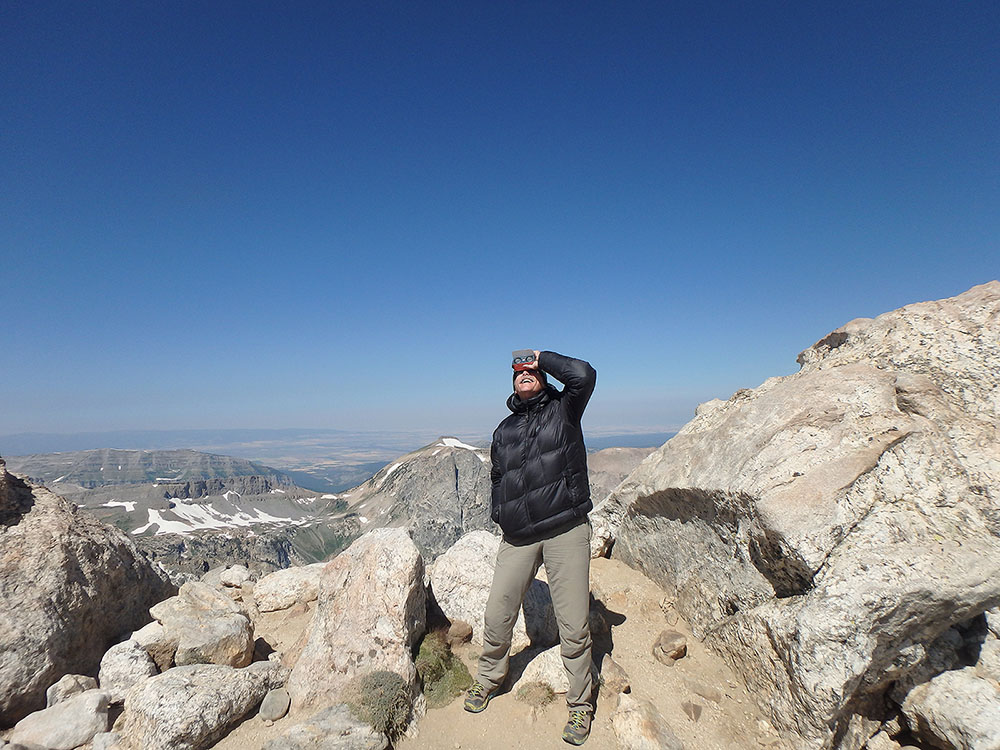Checking out the eclipse with a pair of solar 2x binoculars from the saddle between the Middle Teton and the Grand Teton