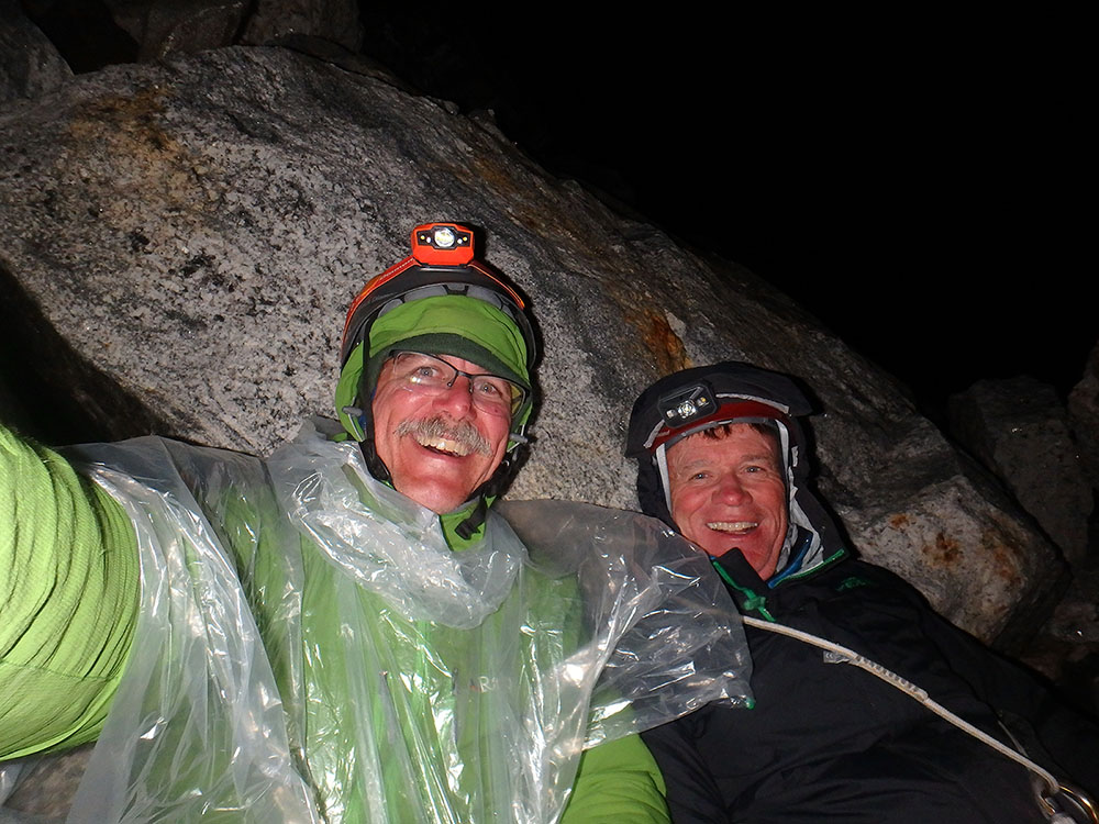 Climbers on a forced bivouac on the descent of the Grand Teton